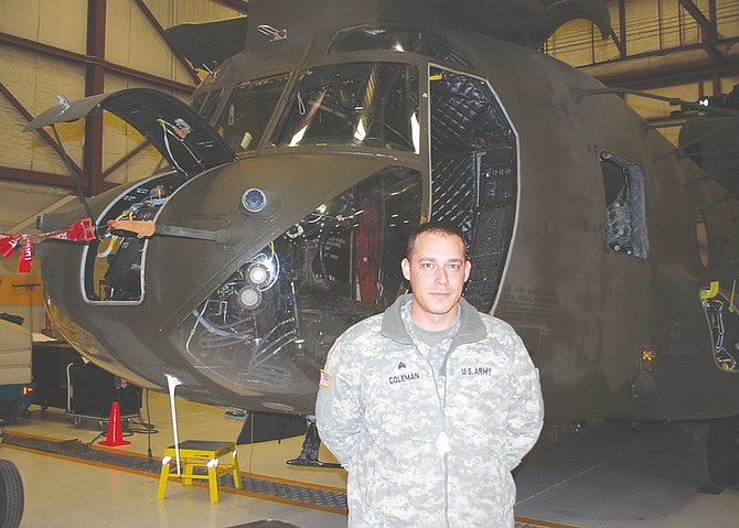Steve Ranson / Lahontan Valley NewsSgt. Jason Coleman of Carson stands next to a Nevada Army National Guard CH-47 helicopter on Friday. Bravo Company, 1-189th General Support Aviation Battalion, will deploy to Afghanistan later this month.