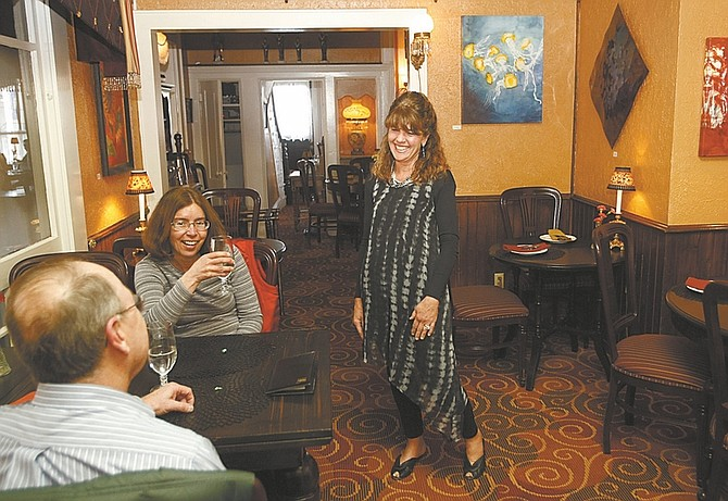 Shannon Litz / Nevada AppealKaren Abowd talks with customers Gary and Rhonda Kilty of Carson City at Cafe at Adele's.