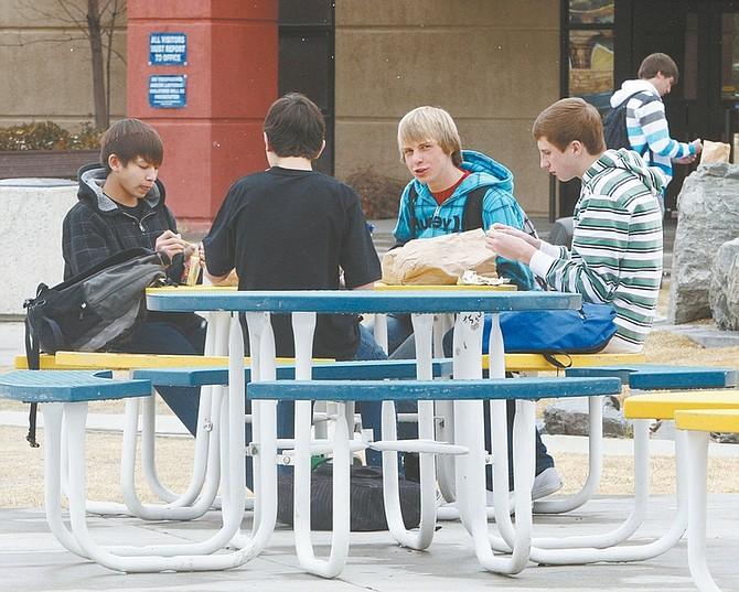 Jim Grant / Nevada AppealCarson High School freshmen, from left, Aaron Woodbury, Joey Cusumano, Corey Reid and Jimmy Redlark eat lunch outside on a chilly afternoon on Monday.