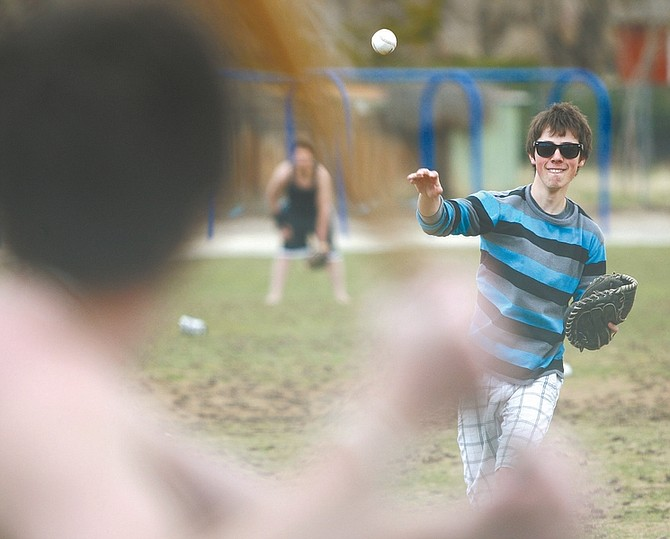 Jim Grant/Nevada AppealMat Boggs, 16, plays a game of pickup baseball with his friends Tuesday on the playground at Bordewich Bray Elementary School.