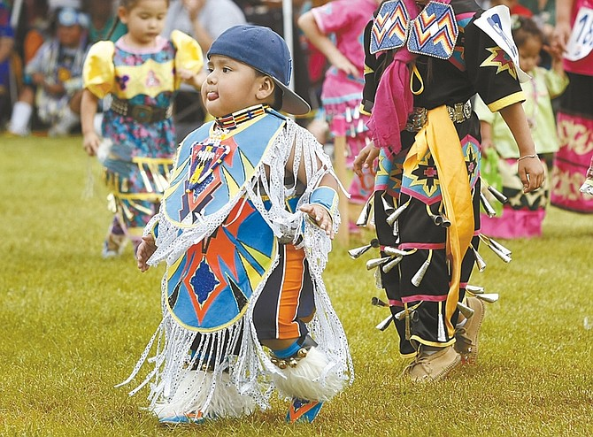 Published Caption: Two-year-old Asa Nelson Jr. dances at the powwow on Saturday.