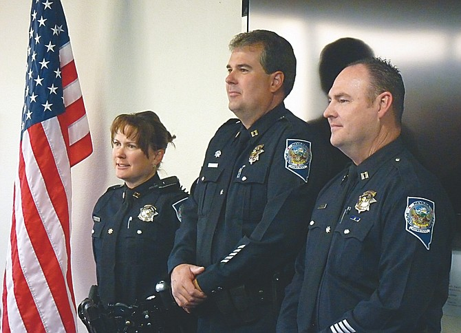 Nick Coltrain / Nevada AppealThe three new Nevada Highway Patrol captains pose for a photo Thursday after the pinning ceremony at the Department of Public Safety. From left: Capts. Susan Aller-Schilling, Tom Merschel and John O'Rourke.