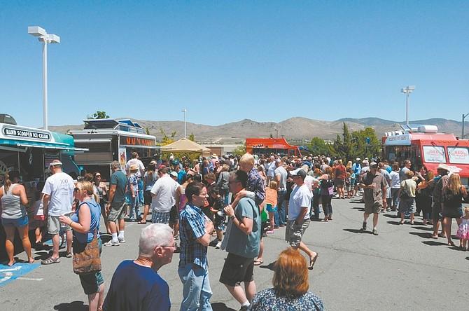 Geoff Dornan / Nevada AppealFood Truck foodies crowd the parking lot Saturday at Casino Fandango for the first Casino Fandango Gourmet Food Truck Festival.