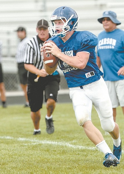 John Byrne / Sparks TribuneAustin Schafer, Carson High's backup quarterback, looks for an open receiver Saturday against Spanish Springs.