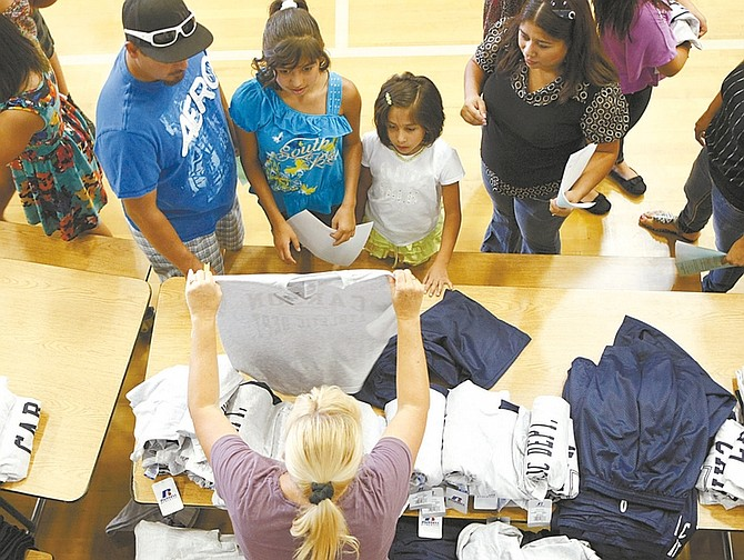 Shannon Litz / Nevada AppealEagle Valley Middle School students and parents check out P.E. uniforms during back to school boot camp on Thursday.