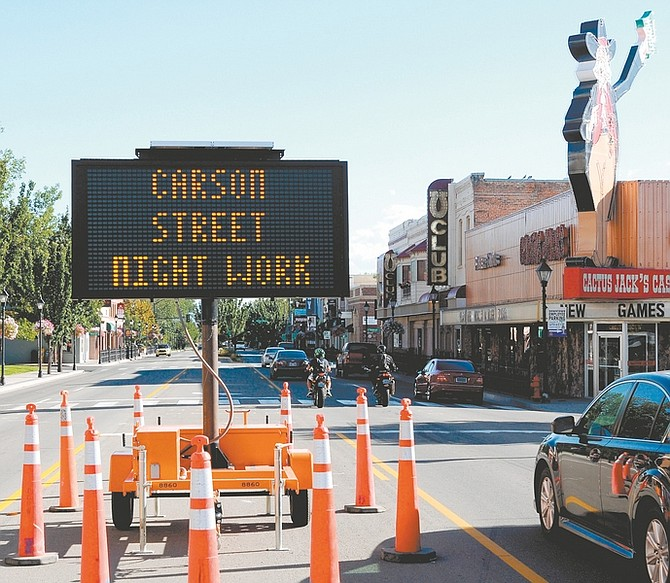 Geoff Dornan/Nevada AppealA sign sits in the middle of Carson Street warning of this week's road construction.