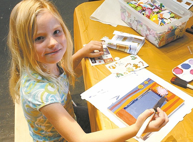 Photos by Wheeler Cowperthwaite / Nevada AppealTempess Hagens, 7, paints a picture frame she assembled for her mother's birthday.