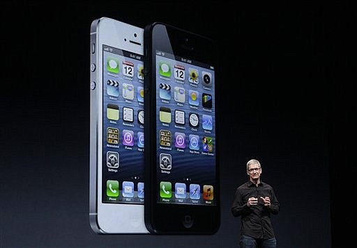 (AP Photo/Jeff Chiu)Apple CEO Tim Cook speaks in front of an image of the iPhone 5 during an Apple event in San Francisco, Wednesday, Sept. 12, 2012.