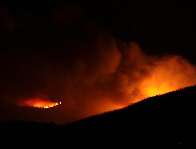 Nancy Vary Hulsey/Special to The R-CFlames from the Carter Springs fire illuminate the night sky.