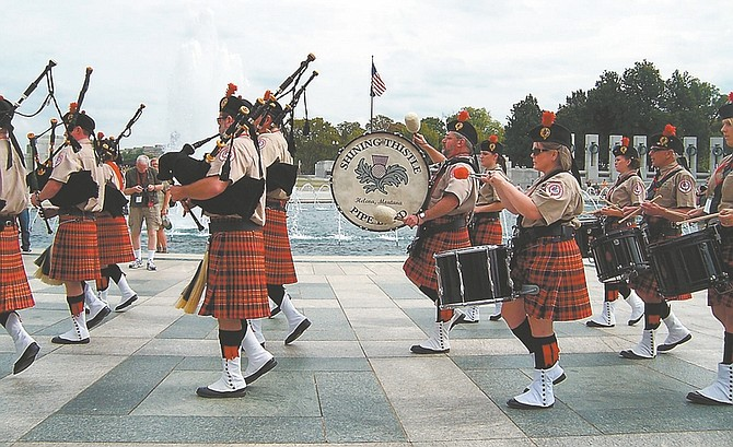 Courtesy Ken Beaton The six bag pipers and six drummers of the Shining Thistle Pipe Band from Helena, Mt., are marching toward the laying of a wreath ceremony at the WW II Memorial in Washington, D.C. on Sept. 28.