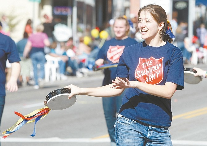 Shannon Litz / Nevada AppealSixteen-year-old Elizabeth Jarett sings and dances along with the Salvation Army float in the Nevada Day parade. For more photos go to nevadaappeal.com/photos.