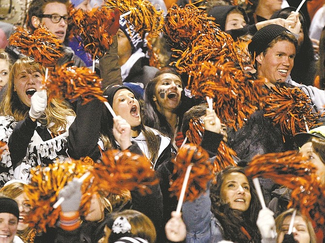 Shannon Litz / Nevada AppealThe Douglas High School student section cheers for the Tigers on Thursday night.