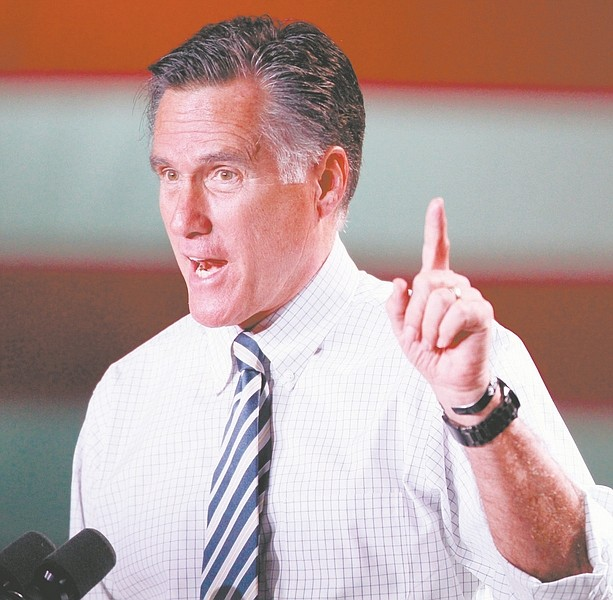 Republican presidential candidate, former Massachusetts Gov. Mitt Romney gestures during a campaign rally in Reno, Nev., Wednesday, Oct. 24, 2012. (AP Photo/Cathleen Allison)