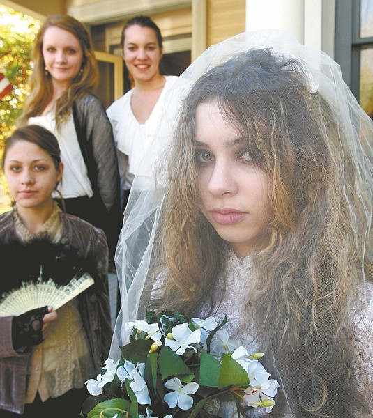 Photos by Jim Grant / Nevada AppealLeft: Ghost bride Isabella Hicks along with, from left, Staci Madrigal, Kira Fugua and Elizabeth Wait lead tours of the Ferris Mansion during the annual Ghost Walk on Saturday.