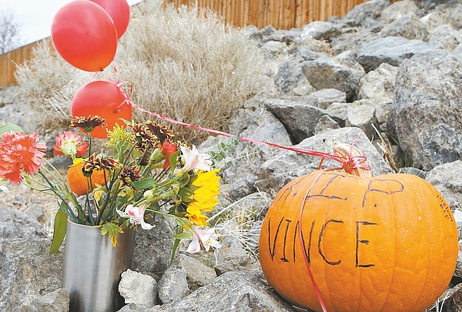 Shannon Litz/Nevada Appeal A memorial for Vincent Wayne Gilpatrick is seen on Carson River Road on Wednesday.
