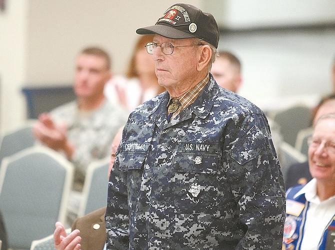 Photos by Shannon Litz / Nevada AppealNate Cerniglia of Carson City stands to be honored as a veteran of World War II during the Carson High School Veterans Day assembly on Wednesday. Cerniglia joined the military at age 16 and served from 1944 to 1947.