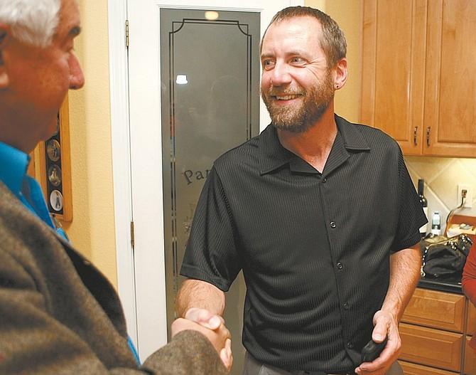 Shannon Litz/Nevada AppealBrad Bonkowski is congratulated on winning the Carson City Supervisor Ward 2 seat by John Wagner on Tuesday night.