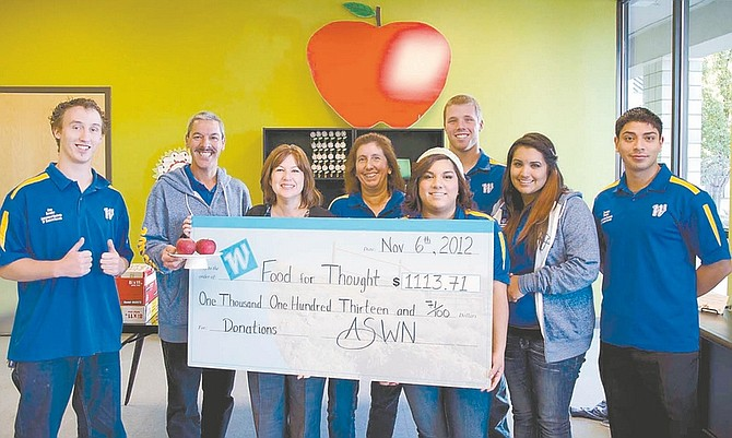 """CourtesyMembers of the Associate Students of Western Nevada College celebrate their gift to """"Food for Thought,"""" which helps ensure that children who live in local motels have food to eat during the weekends."""