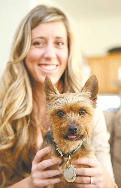 Shannon Litz / Nevada AppealEighteen-year-old Cara Dopf holds Polo, an 8-year-old Yorkshire terrier, on Wednesday.