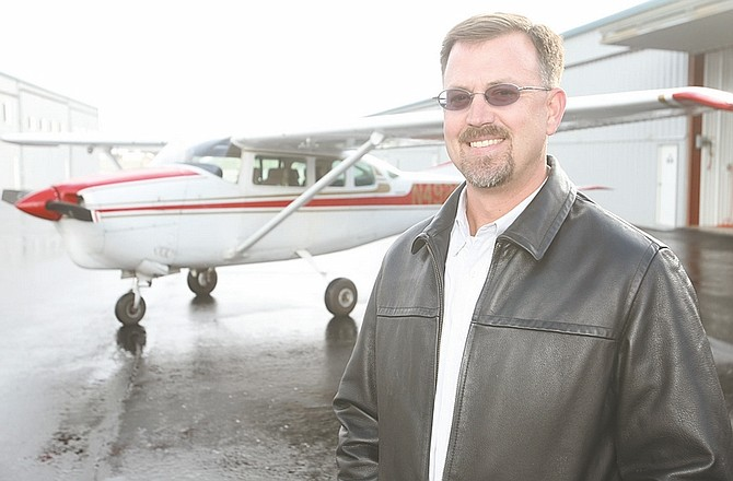 Shannon Litz / Nevada AppealTom Young, seen with his Cessna 210 at the Carson City Airport, is a volunteer pilot for Angel Flight West.