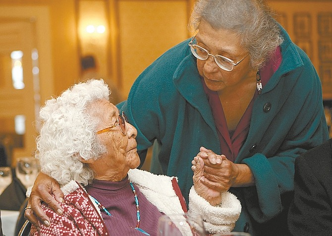 PHOTOS BY Shannon Litz / Nevada AppealHarriet Allen greets Flora Greene at the Governor's Mansion on Saturday night before the American Indian Achievement Awards Banquet.
