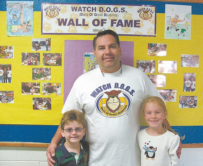 Courtesy photosTed Rupert, with children Jett, 6, and Keela, 7, volunteers with the Watch DOGS at Fritsch Elementary Program. The program is aimed at getting fathers and other male role models involved in schools.