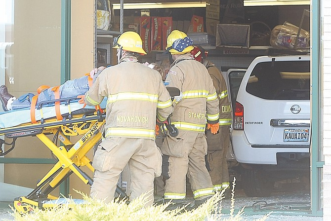 Shannon Litz / Nevada AppealA white Nissan Pathfinder drove through the front window of the store Tuesday Morning, on Friday leaving three people injured.