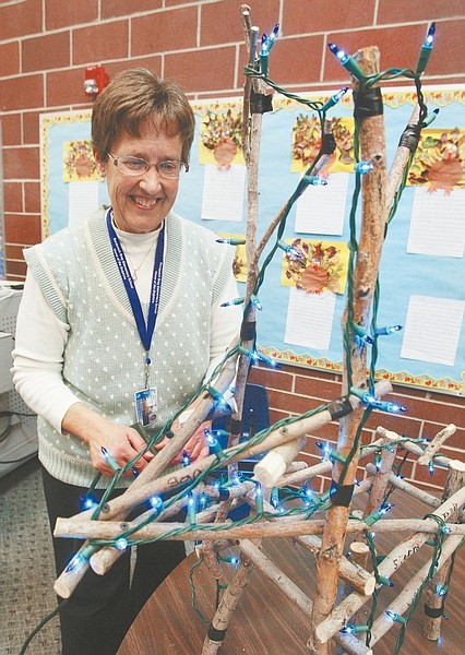 Jim Grant / Nevada AppealSusan Peterson, a second grade teacher at Bordewich Bray Elementary school tests the holiday lights on a willow reindeer that her students made.