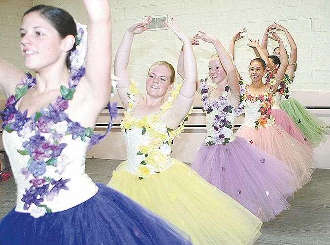 Shannon Litz / Nevada AppealThe flowers dance during The Nutcracker rehearsal last weekend. The ballet, which follows Clara through a Christmas dream where the Nutcracker comes to life, will open Friday and run through Sunday at the Carson City Community Center.