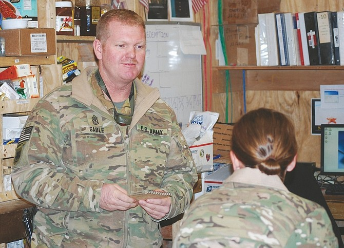Photos by Steve Ranson / Lahontan Valley News1st Sgt. Don Gable of Bravo Company, 189th General Support Aviation Battalion, talks to Chinook pilot CW2 Casey Atkins.
