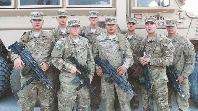 Staff Sgt. Kimberly Wadsworth / 593rd PAORight: Four pairs of Nevada Army brothers in the 593rd Transportation Company serve together at Camp Phoenix, Afghanistan. From left are Spc. Bobby Riley, Pvt. Jason Otto, Spc. James Riley, Cpl. Donald Otto, Pfcs. Matthew and Christopher Babas, Sgt. Christopher Greener and Spc. Dustin Greener.