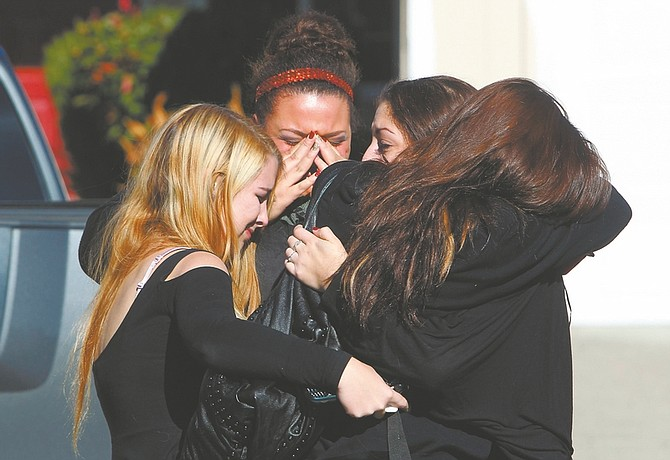 From left, Mariah Harvey, 17, Jazmine Taylor, 18, Taylor Dardis, 17, and Chanel Kelly, 16 cry together outside the Petaluma, Calif. home of their friend, Alyssa Byrne, 19, whose body was discovered Friday morning, Jan. 4, 2013 in South Lake Tahoe. Byrne was reported missing on New Year's Eve. (AP Photo/The Press Democrat, John Burgess)