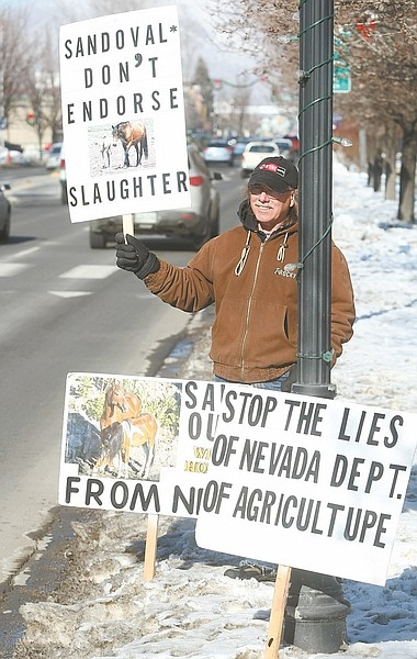 Shannon Litz / Nevada AppealRalph Arista of Virginia City holds a sign in front of the Nevada Legislature on Friday afternoon.