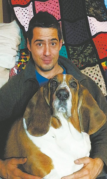 Andrew W. Russell with Fredrick the Basset Hound.
