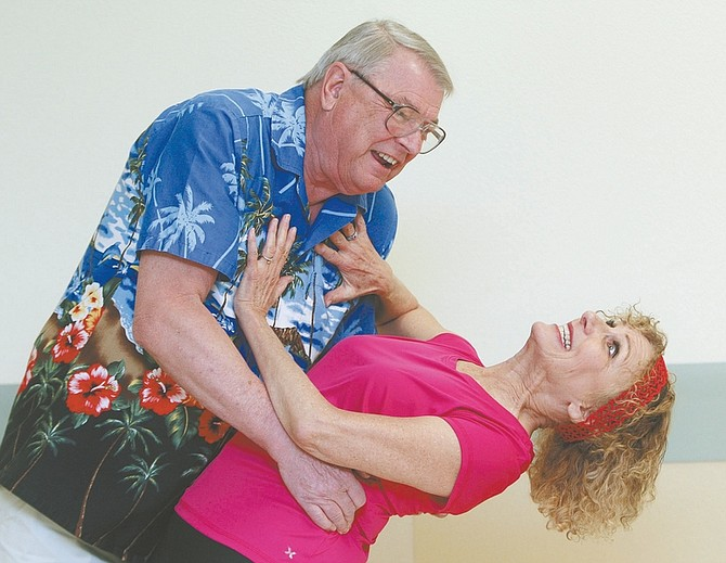 "Jim Grant / Nevada AppealCast members Tom Tomashek and Sheila Steele rehearse a scene for ""Murder on the Lust Boat"", which opens on Friday night at the Gold Dust West Casino Hotel."