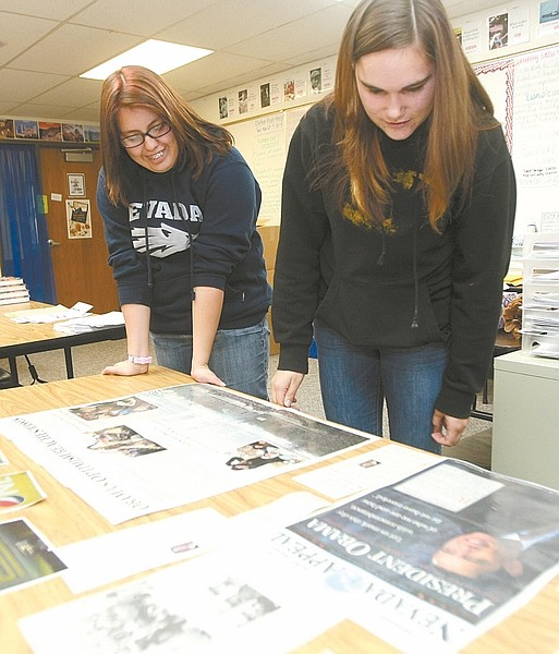 Photos by Shannon Litz / Nevada AppealCarson High School senior Leticia Echeverria and junior Carly Schmidlin look over newspaper clippings from the last presidential inauguration on Thursday in Angila Golik's class.