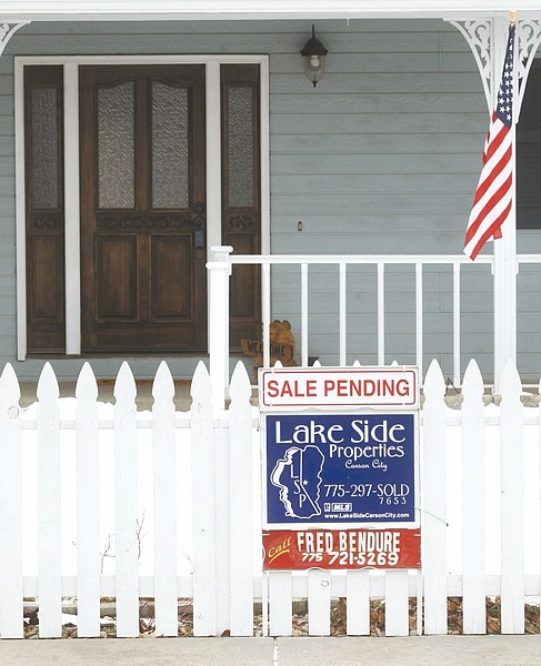 Shannon Litz / Nevada AppealA sale pending sign is posted in south Carson City on Friday. Realtors expect 2013 to be a better year than 2012 for the market.