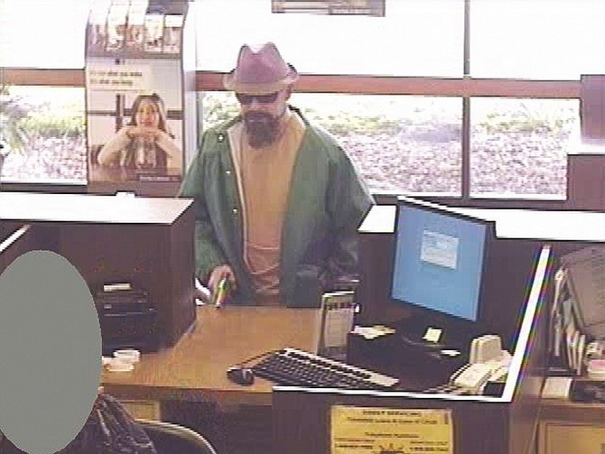Tahoe Daily Tribune file photoThe Fedora Bandit, David Griffith Osborne, is shown at a Bank of the West in Gridley, Calif., in 2010. Osborne pleaded guilty to a string of heists, including the Gridley hold-up and two Lake Tahoe bank robberies, on Friday.