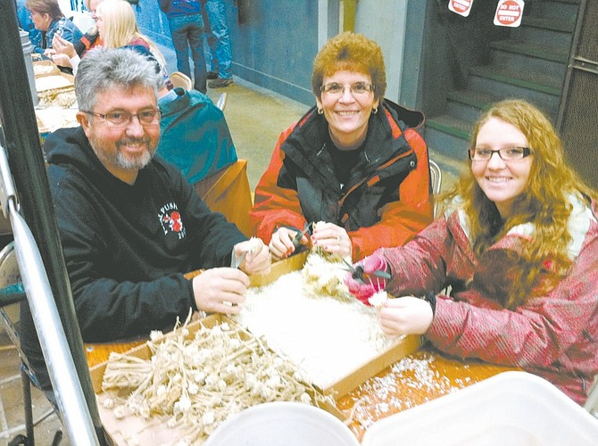 Carson City's Steve, Kathy and Bethany White were among the thousands of volunteers involved in decorating floats for the 2013 Rose Parade.