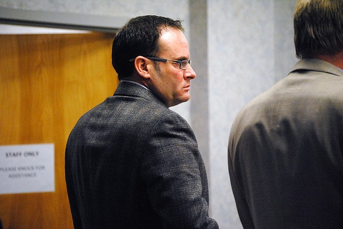 Steve PuterskiKeith Alan Thomas of Carson City watches opening statements during Monday's trial in the Tenth Judicial District Court in Fallon. Thomas face two felony weapons charges after shooting Michael Gallardo of Fernley on Aug. 16, 2011.