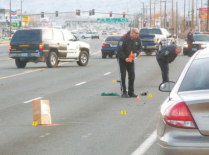 Wheeler Cowperthwaite / Nevada AppealNevada Highway Patrol troopers document the scene of the fatal hit-and-run on William Street on Friday morning.