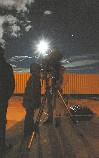 Shannon Litz / Nevada Appeal Visitors look through a telescope at the Western Nevada College observatory. Star Parties are every Saturday at sunset when skies are clear.