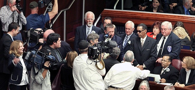 Jim Grant / Nevada Appeal Assemblyman Steven Brooks takes his seat in the Nevada Assembly surrounded by media on Monday.