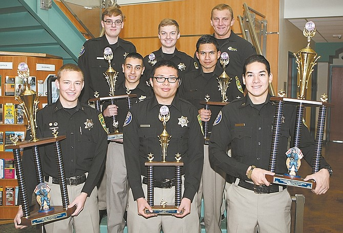 Shannon Litz / Nevada AppealCarson City Sheriff's Explorers are, back row, Austin Nichols, Joshua Van Sickle and Luke Remer. Middle row: Isaac Ramirez and Alejandro Gomez and in the front are Capt. Ian Carl, Tulio Marroquin and Sgt. Elan Flores. The explorers competed in the Tactical Competition in Chandler, Ariz.