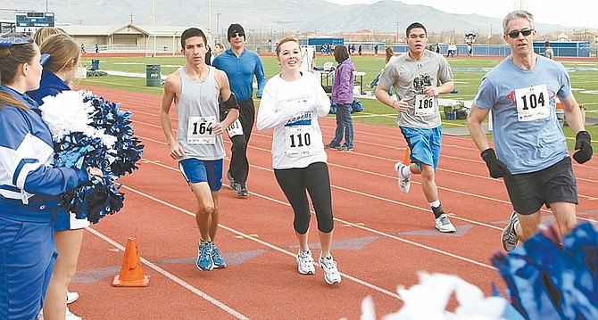 PHOTOS BY Shannon Litz/ Nevada AppealCarson High School cheerleaders line the route of the Safe Grad 5K at CHS-on Saturday.