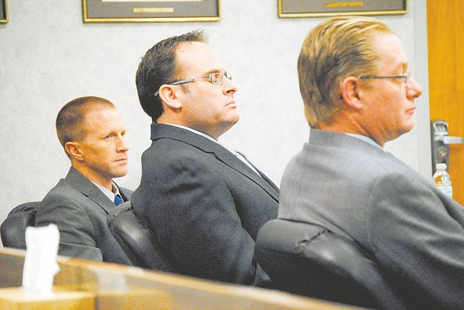 Steve Puterski / Lahontan Valley newsKeith Alan Thomas of Carson City listens to Senior Judge Robert Estes after a not guilty verdict on Friday in the Tenth Judicial District Court in Fallon. Thomas faced two felony weapons charges stemming from a shooting on Aug. 16, 2011.
