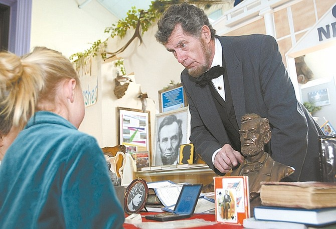 Shannon Litz / Nevada AppealWally Earhart, as Abraham Lincoln, talks with 6-year-old Sophia and 5-year-old Elaina Mack on Saturday at the Children's Museum of Northern Nevada.