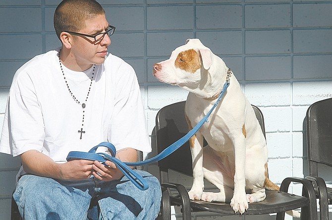 Shannon Litz / Nevada AppealMartin Andrade and 8-month-old Jillian, an American terrier mix, sit in the yard at Warm Springs Correctional Center on Thursday.
