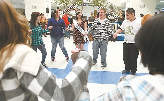 Shannon Litz/Nevada Appeal Miss Washoe Olivia Rupert, 18, at Carson High School senior, leads a dance in Senator Square during lunch at the school on Wednesday.