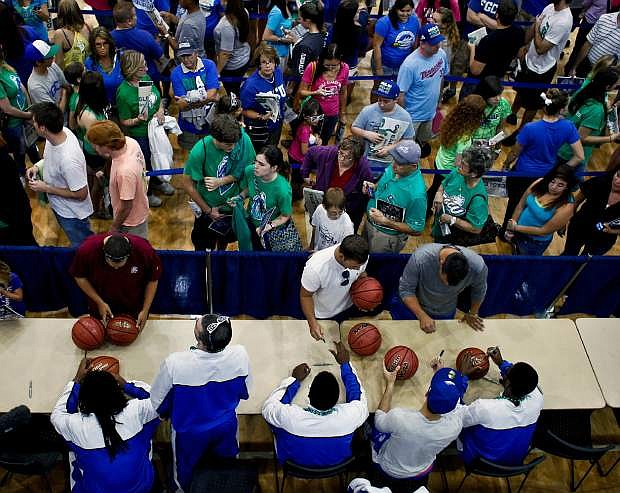 Fans wait in line to get autographs from the team during an NCAA college basketball pep rally for the Florida Gulf Coast men's team at Alico Arena on Monday, March 25, 2013, in Fort Myers, Fla.  FGCU is scheduled to play Florida on Friday in the South Regional semifinals game of the NCAA college basketball tournament. (AP Photo/Naples Daily News, William DeShazer)  FORT MYERS OUT